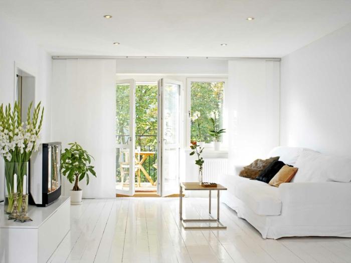 wohntrends weißes wohnzimmer pflanzen holzboden fernseher