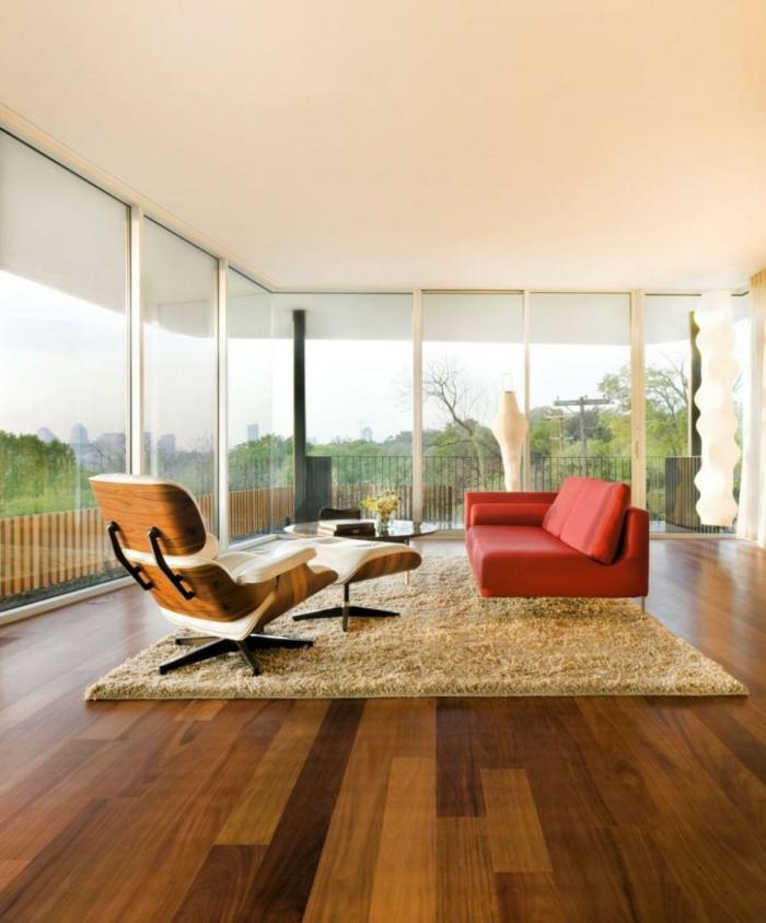 Wohnzimmer Einrichten Beispiele Minimalistisch Oranges Sofa Beiger Teppich Panoramafenster