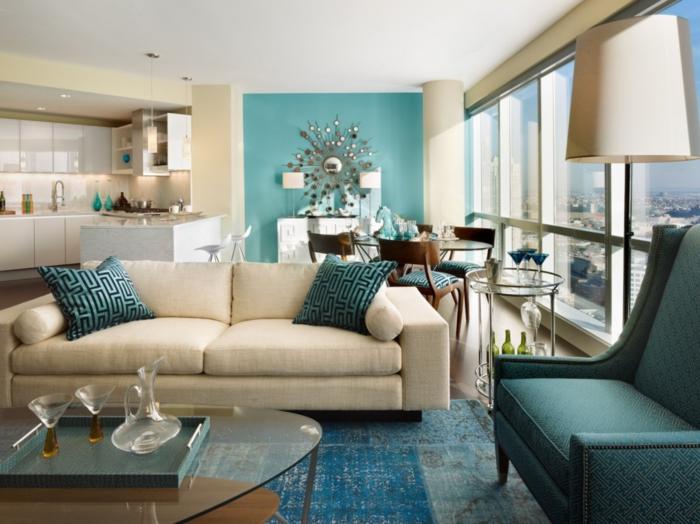 wohnzimmer einrichten ideen blaunuancen glastisch offener wohnplan
