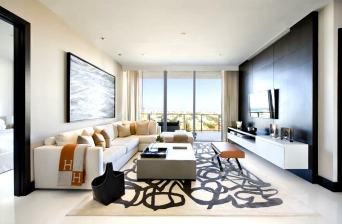 wohnzimmer einrichten ideen weiße möbel teppichmuster orange akzente