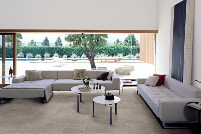 wohnzimmer fliesen bodenbelag schicke sofas runde tische