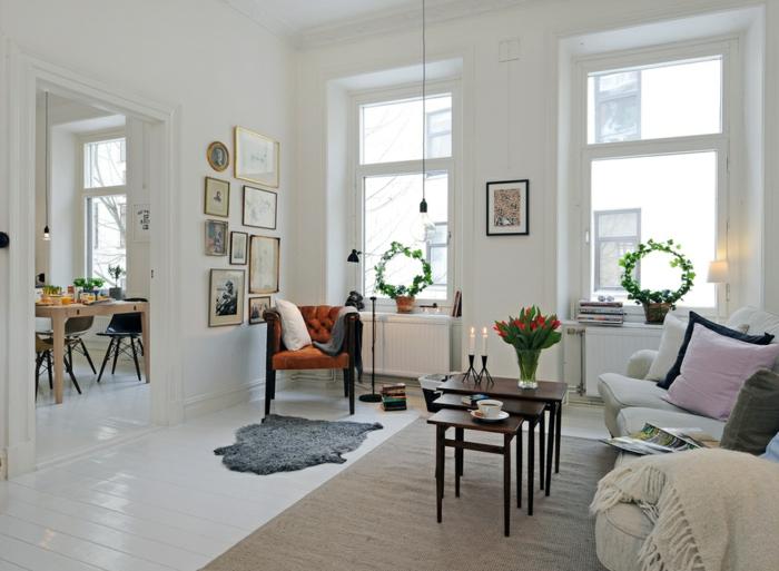 wohnzimmereinrichtung ideen skandinavischer stil kerzen teppiche pflanzen