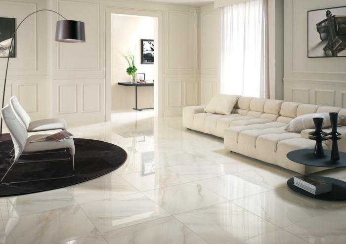 wohnzimmerfliesen hell gemütliches wohnzimmer luxuriös runder schwarzer teppich