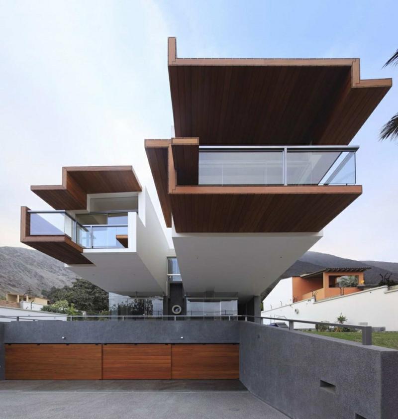 Moderne Architektur Häuser bauen Architektenhaus Hausfassade Holz Beton