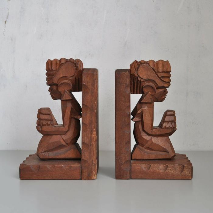 buchstützen holz schnitzerei afrikanische kunst figuren