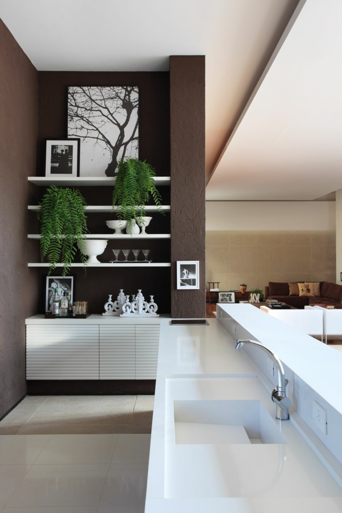 moderne küchen offener wohnplan wohnzimmer braune wände pflanzen