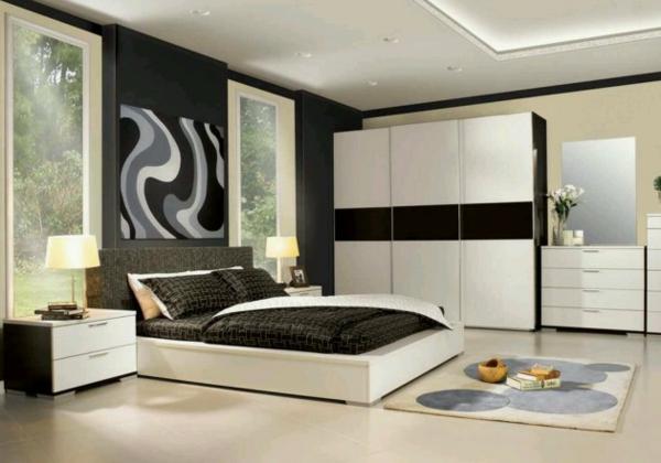 schlafzimmer einrichten weiße schränke abstrakte wandkunst teppich nachtkonsole