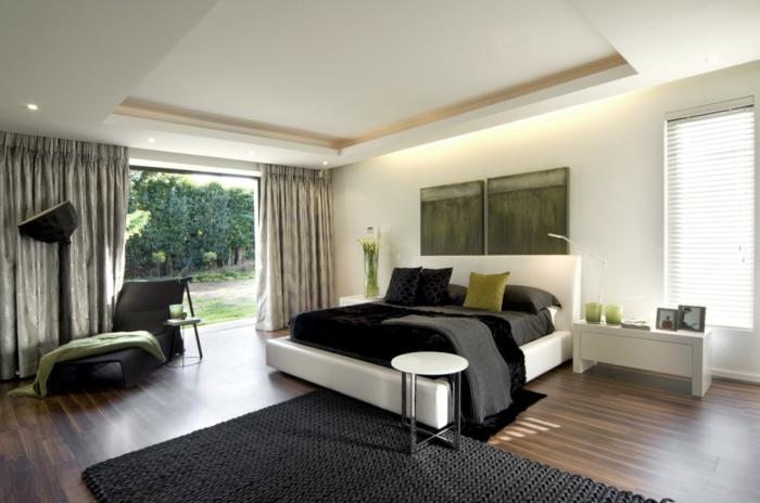 schlafzimmer schwarz weiß weißes bett schwarzer teppich grüne akzente