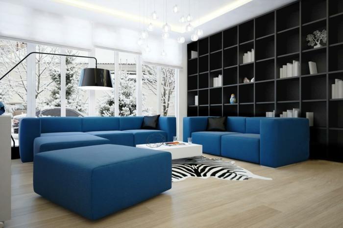 zebra wohnzimmer:sofa blau zebra teppich regalwand stauraum wohnzimmer heller boden
