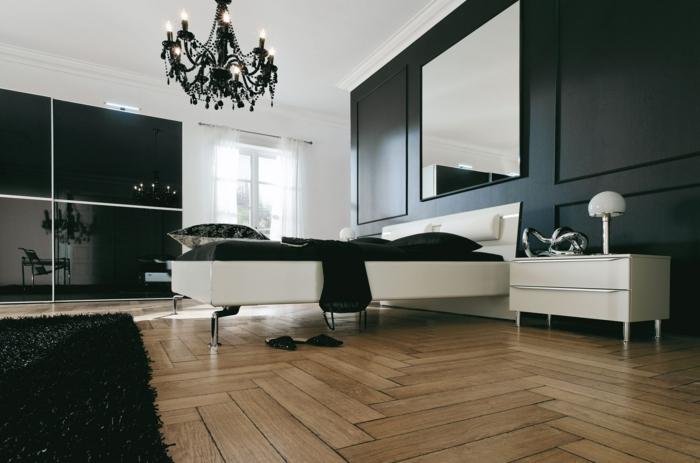 wohnideen schlafzimmer schwarz weiß holzboden leuchter