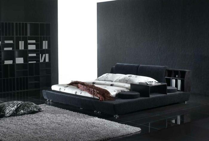 wohnideen schlafzimmer schwarze bodenfliesen grauer teppich bibliothek