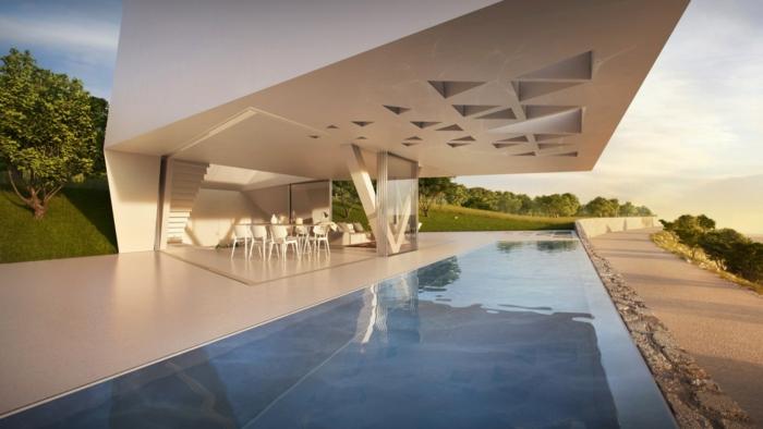 außergewöhnliche ferienhäuser moderne architektur futuristisch beton außenpool