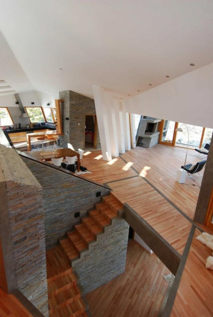 außergewöhnliche ferienhäuser ribbon house moderne architektur holzboden naturstein wandverkleidung