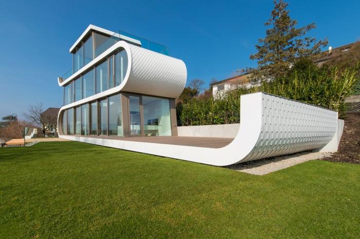 außergewöhnliche ferienhäuser schweiz wellen moderne architektur organische formen