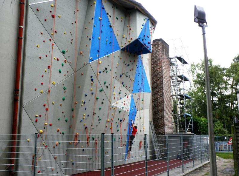 gesund abnehmen Sport treiben Kletterwand