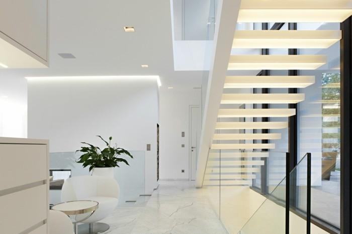 moderne treppen beleuchtet weißes innendesign pflanzen