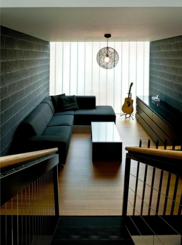 schönes wohnzimmer dunkles sofa minimalistische einrichtung