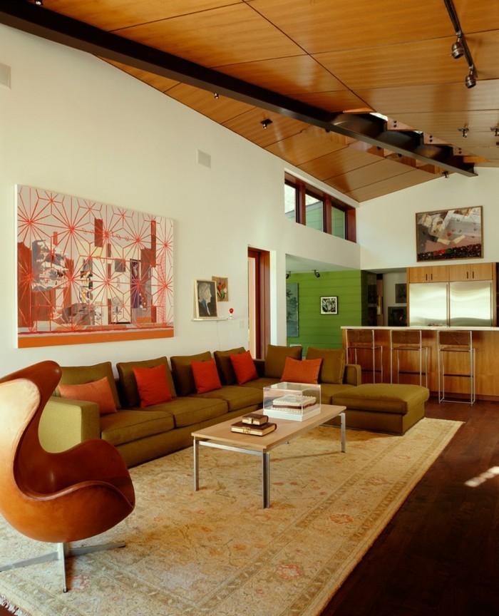 schönes wohnzimmer farbige akzente dekokissen cooler sessel