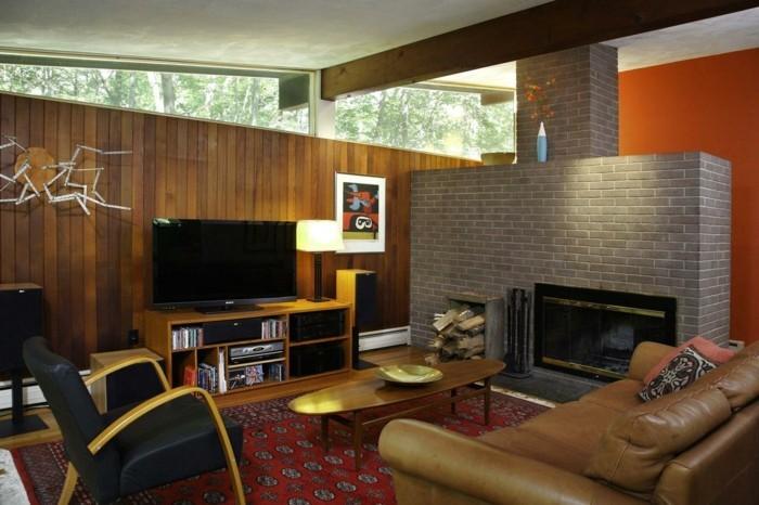 schönes wohnzimmer feuerstelle steinwand dekoideen roter teppich