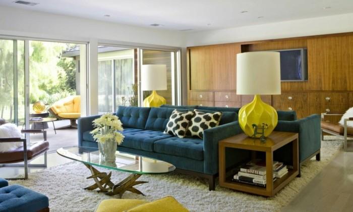 schönes wohnzimmer gelbe akzente weißer teppich ovaler couchtisch