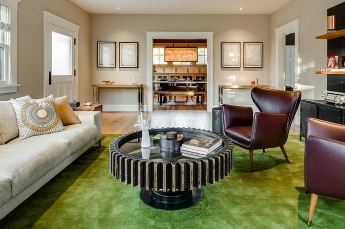 schönes wohnzimmer grüner teppich cooler couchtisch
