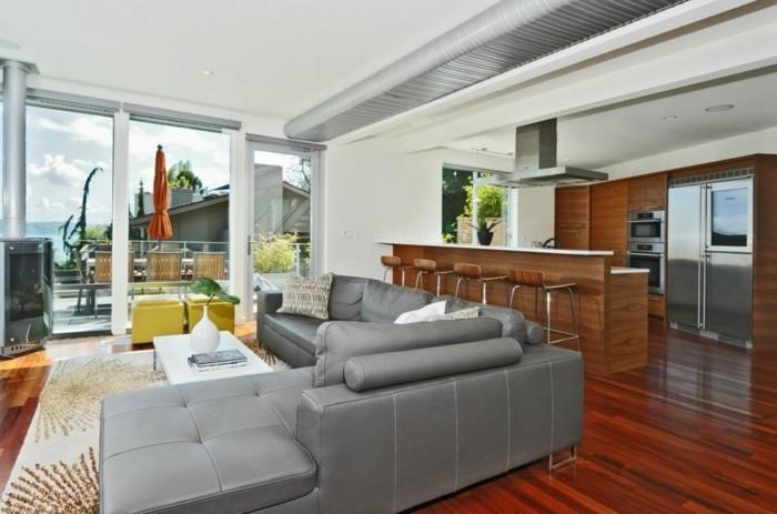 schönes wohnzimmer graues sofa offener wohnplan eleganter teppich