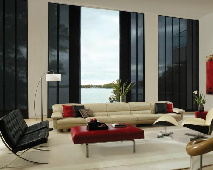 schönes wohnzimmer rote akzente pflanzen ledermöbel