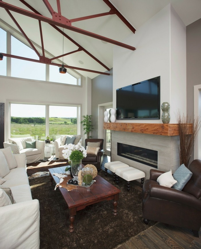 schönes wohnzimmer weiße möbel dunkler teppich kamin