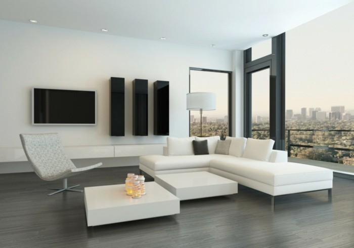 schönes wohnzimmer weiße möbel schwarze wandregale grauer bodenbelag