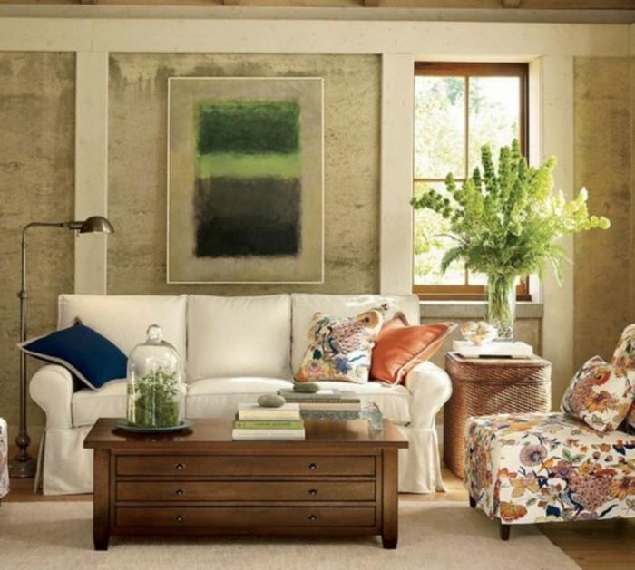 schönes wohnzimmer weißes sofa farbige stoffmuster heller teppich