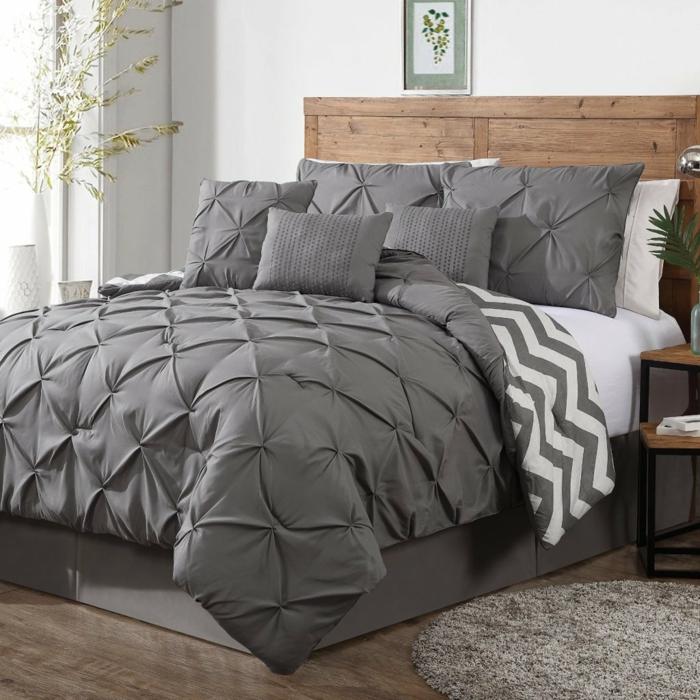 einrichtungsideen grau schlafzimmer graue bettwäsche runder teppich pflanzen