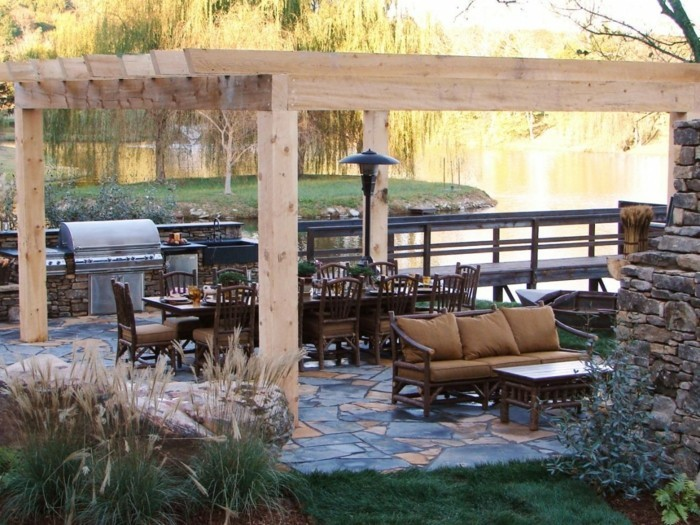 terrassenüberdachung pergola bauen strohhütte weiß kühl