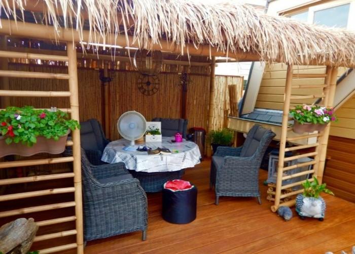 terrassenüberdachung pergola bauen strohhütte