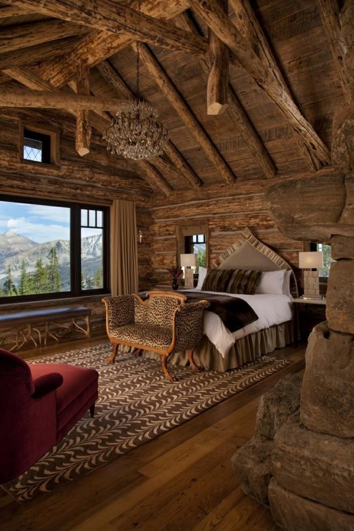 wohnideen schlafzimmer schöner teppich cooler leuchter holzbalken