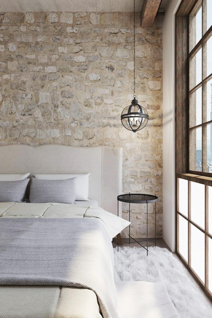 wohnideen schlafzimmer weißer teppich steinwand landhausstil