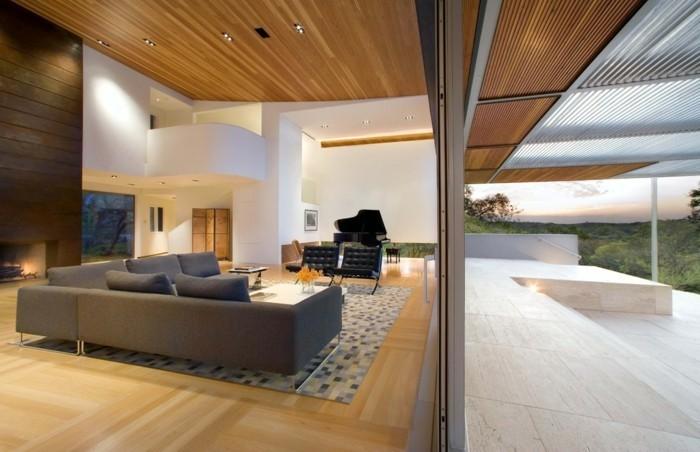 wohnideen wohnzimmer geometrischer teppich geräumig moderne beleuchtung