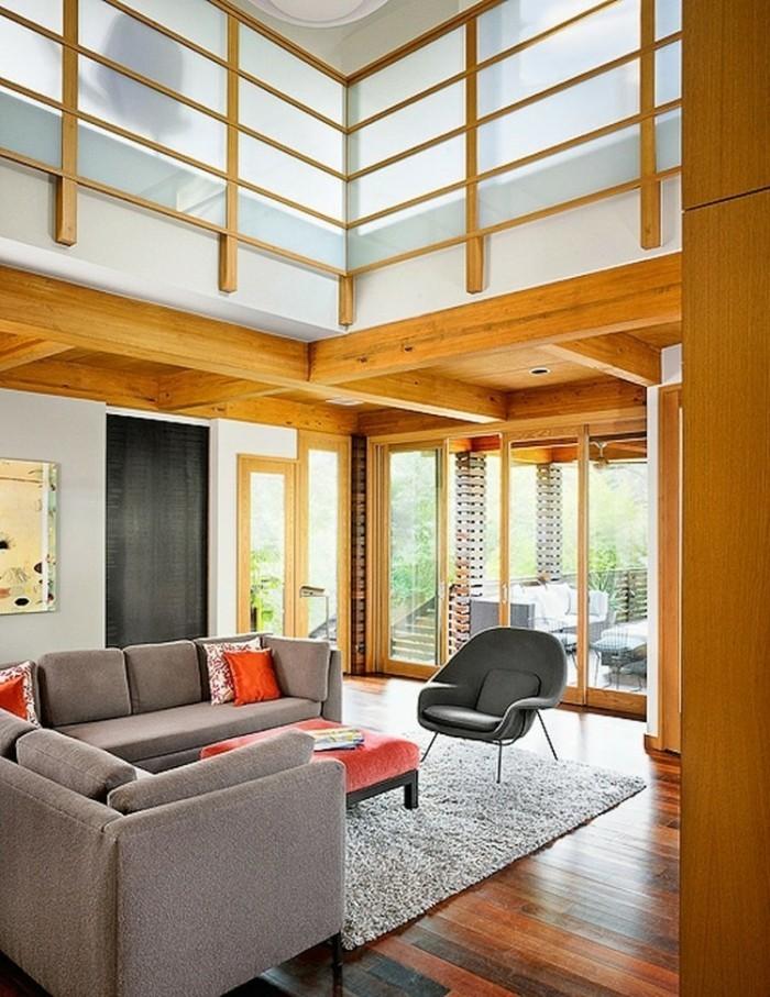 wohnideen wohnzimmer graue möbel teppich orange dekokissen