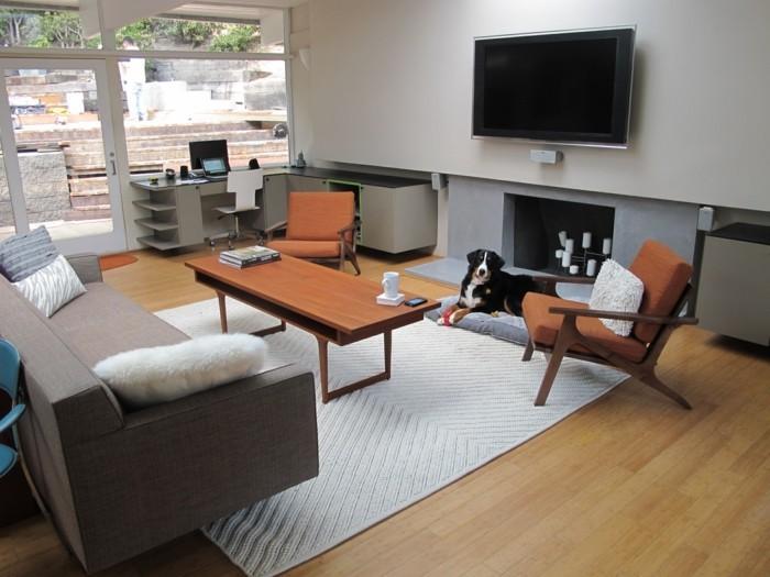 wohnideen wohnzimmer hellgrauer teppich schickes sofa
