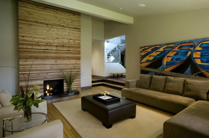 wohnideen wohnzimmer kamin beiger teppich schickes sofa akzentwand