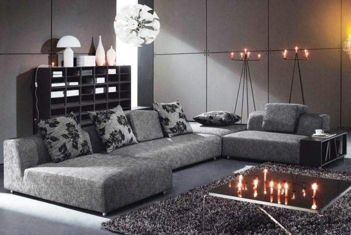 wohnideen wohnzimmer schicke möbel graue wände teppich dekokissen kerzen