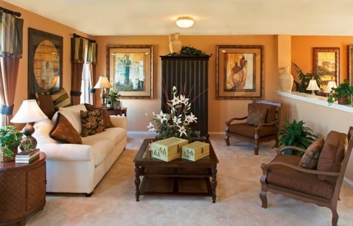 wohnideen wohnzimmer teppichboden weißes sofa orange wände
