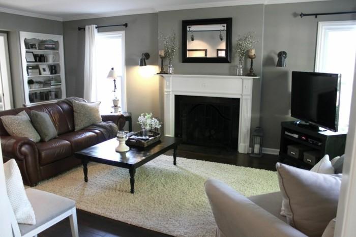 wohnideen wohnzimmer weißer teppich braunes ledersofa graue wände