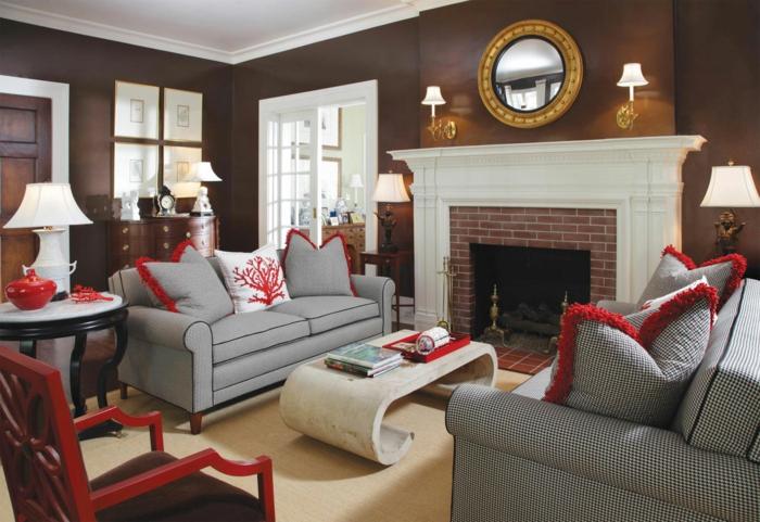 wohnzimmer braun braune wände kamin rote akzente heller teppich