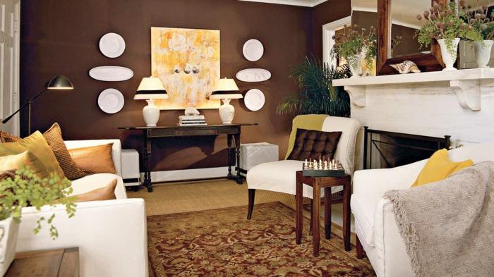 wohnzimmer braun weiße möbel wanddeko pflanzen