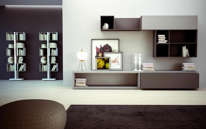 wohnzimmer braun braunnuancen teppich moderne wohnwand weiße akzente bücher stauraum