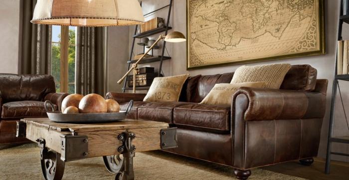 wohnzimmer braun ledermöbel ausgefallener couchtisch weltmappe