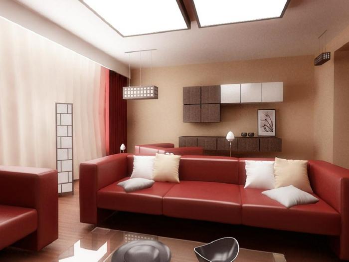 wohnzimmer braun rote ledermöbel beige dekokissen led beleuchtung