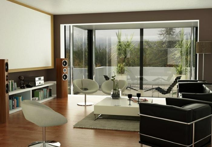 wohnzimmer braun wandgestaltung dunkeltöne weiße stühle schwarze sessel