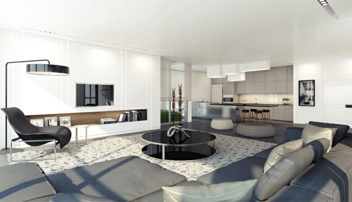 wohnzimmer grau graues sofa heller teppich runder couchtisch weiße wände
