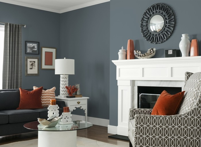 wohnzimmer grau mit weißem teppich und modernem runden couchtisch